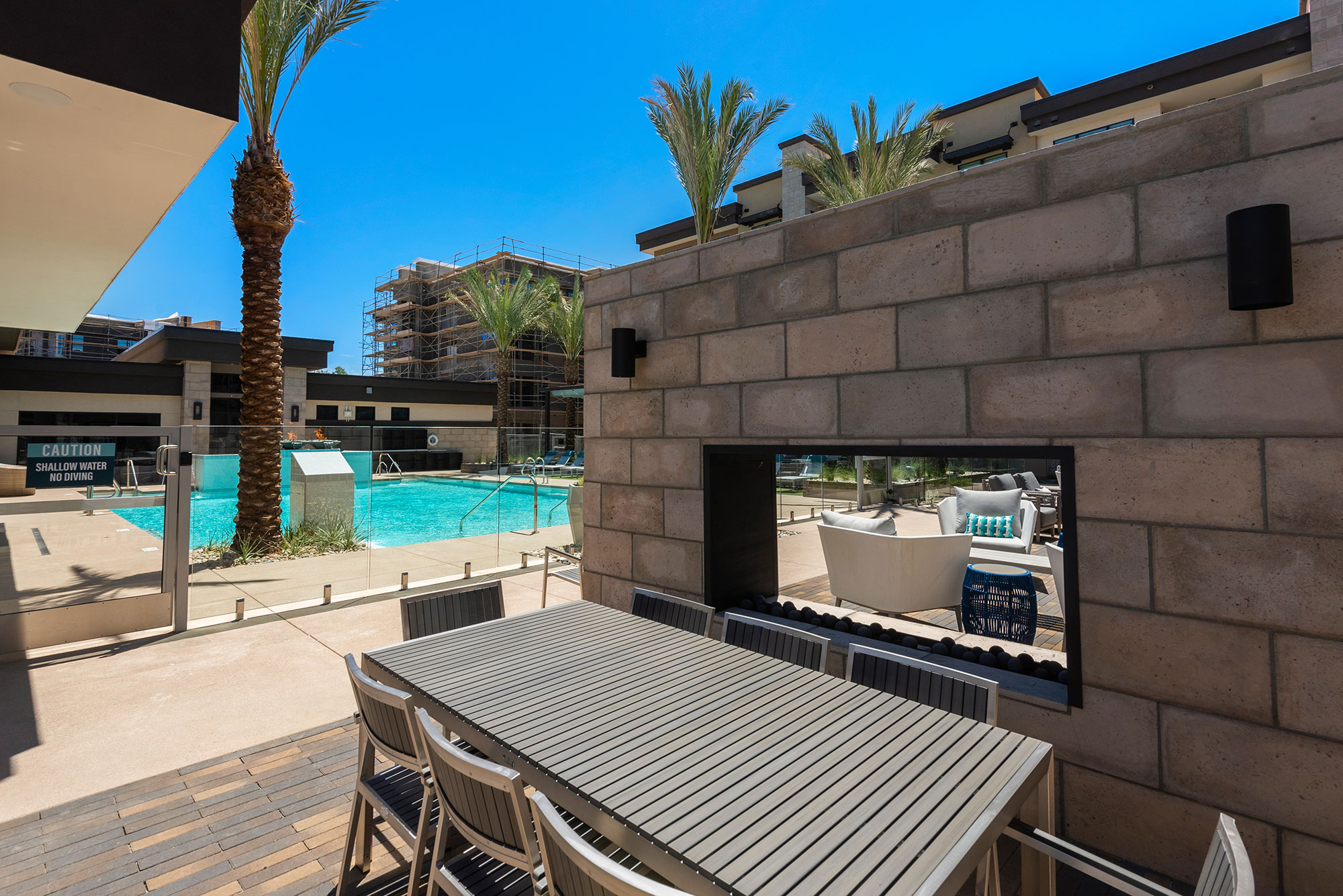 Riata - Poolside with outdoor fireplace