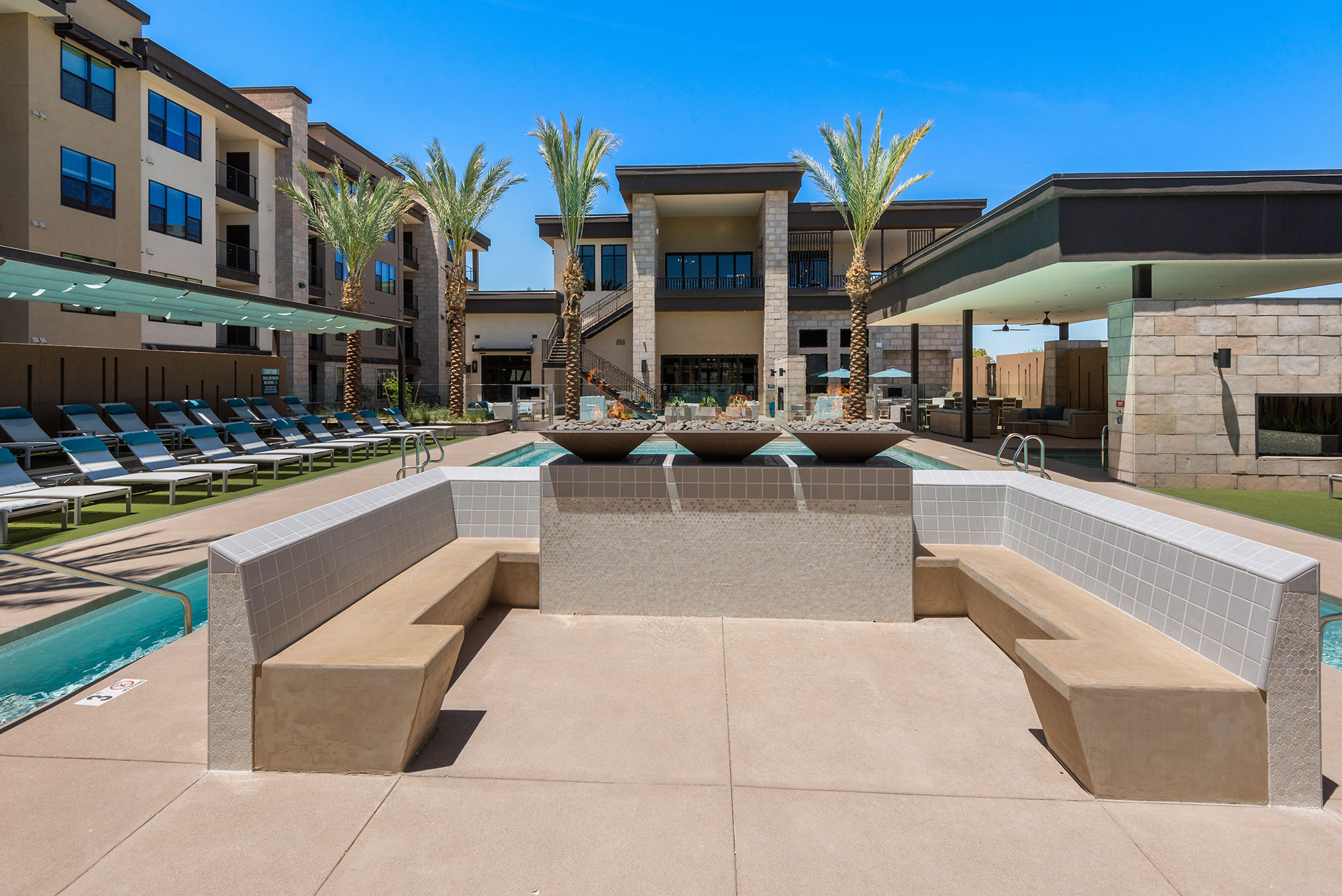 Riata - Poolside loung area with stone seating