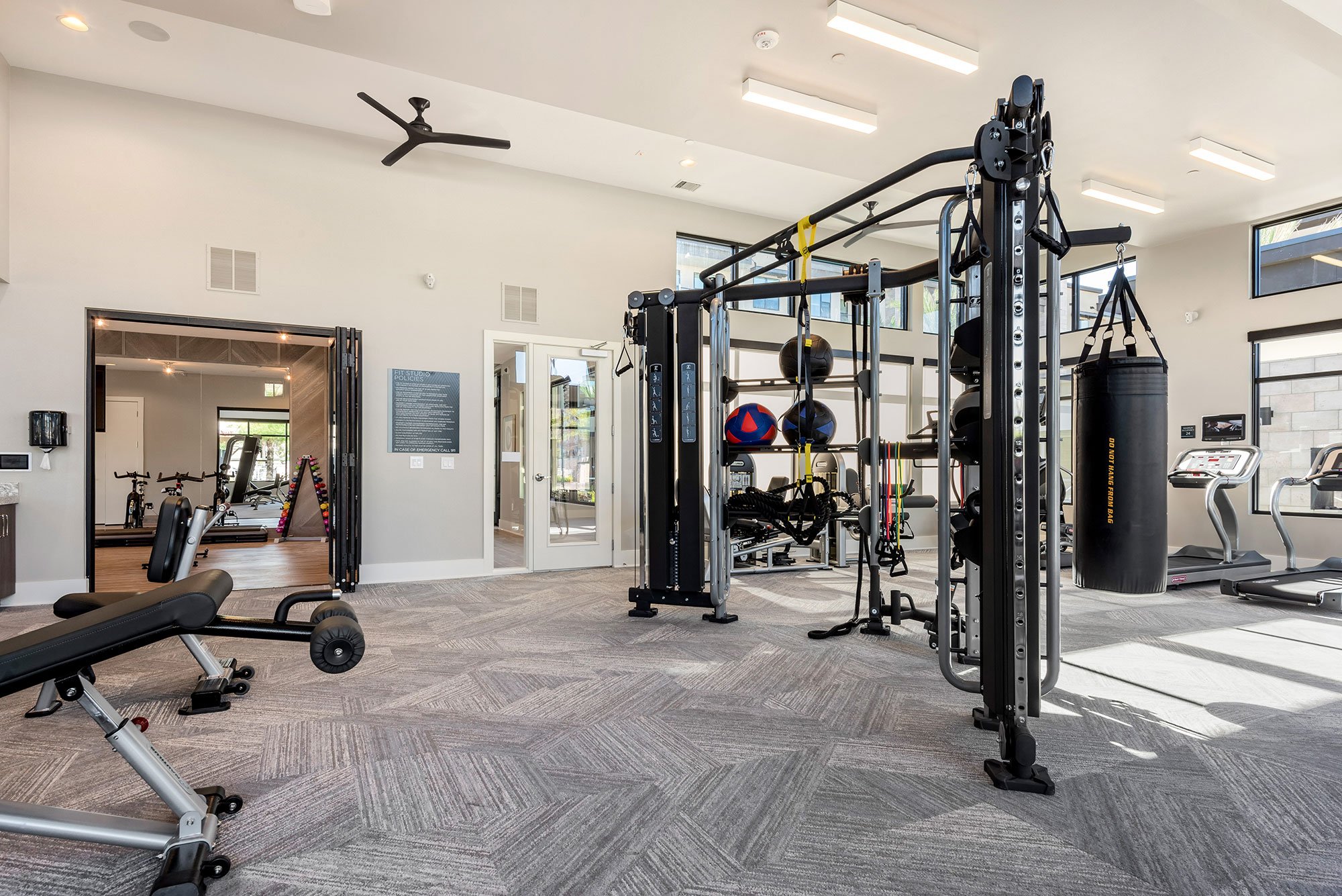 Riata - Fitness room with resistance band machine